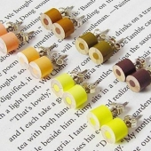 color pencil ear studs yellow brown