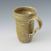 hand thrown mug in caramel brown