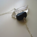 Contrasting clear smooth natural crystal quartz point paired with rugged black t