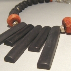 An untamed necklace of onyx, lava and coral